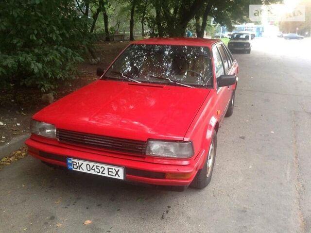 Красный Ниссан Блюберд, объемом двигателя 2 л и пробегом 400 тыс. км за 1700 $, фото 1 на Automoto.ua