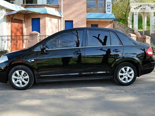 Черный Ниссан Тиида, объемом двигателя 1.6 л и пробегом 70 тыс. км за 8400 $, фото 1 на Automoto.ua