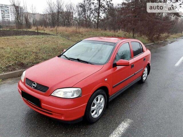 Красный Опель Астра Г, объемом двигателя 0 л и пробегом 198 тыс. км за 4999 $, фото 1 на Automoto.ua