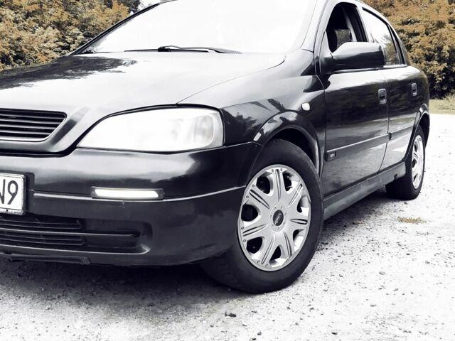 Черный Опель Астра, объемом двигателя 1.9 л и пробегом 350 тыс. км за 1306 $, фото 1 на Automoto.ua