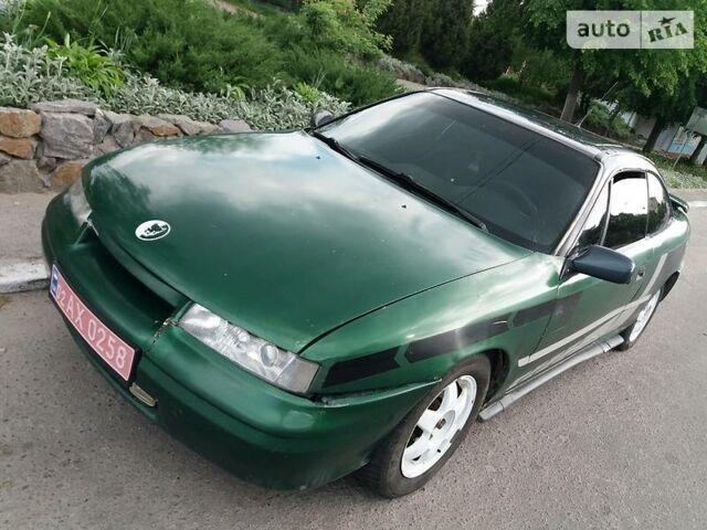 Зелений Опель Калібра, об'ємом двигуна 2 л та пробігом 430 тис. км за 2600 $, фото 1 на Automoto.ua