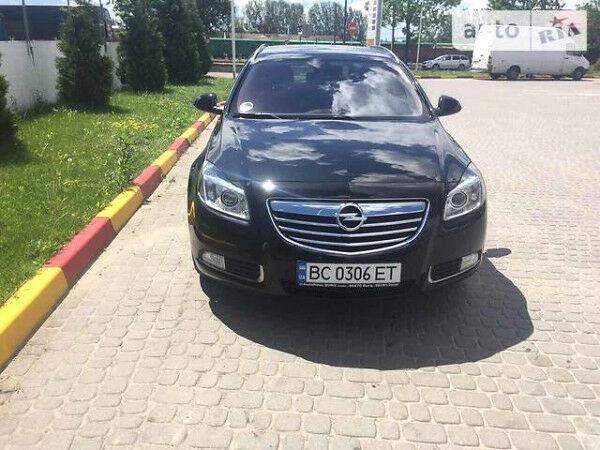 Черный Опель Инсигния, объемом двигателя 2 л и пробегом 110 тыс. км за 12500 $, фото 1 на Automoto.ua