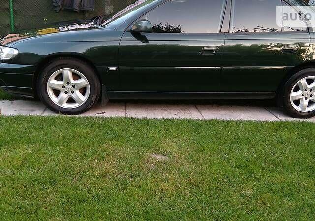 Зеленый Опель Омега, объемом двигателя 2.2 л и пробегом 334 тыс. км за 5100 $, фото 1 на Automoto.ua