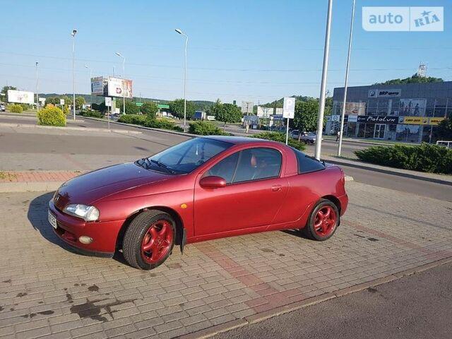 Червоний Опель Тігра, об'ємом двигуна 1.4 л та пробігом 188 тис. км за 3700 $, фото 1 на Automoto.ua