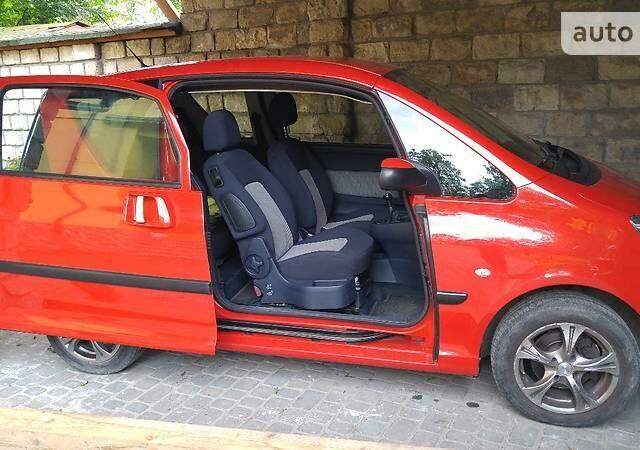 Червоний Пежо 1007, об'ємом двигуна 1.4 л та пробігом 80 тис. км за 4700 $, фото 1 на Automoto.ua