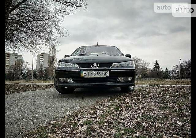 Черный Пежо 406, объемом двигателя 1.8 л и пробегом 159 тыс. км за 5999 $, фото 1 на Automoto.ua