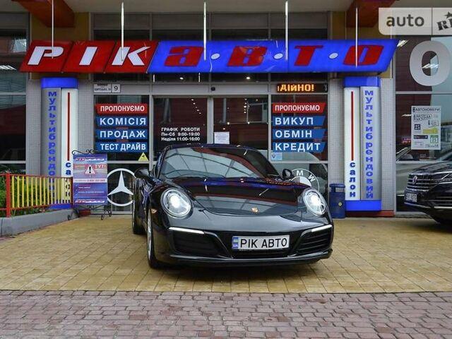 Черный Порше 911, объемом двигателя 3 л и пробегом 31 тыс. км за 99900 $, фото 1 на Automoto.ua