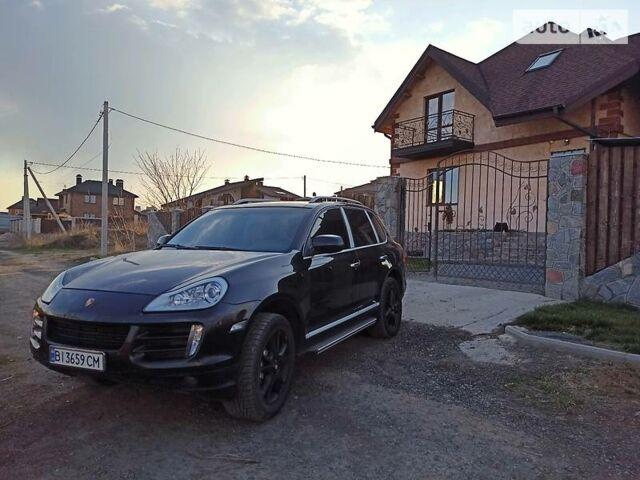 Черный Порше Каен, объемом двигателя 4.8 л и пробегом 200 тыс. км за 14000 $, фото 1 на Automoto.ua