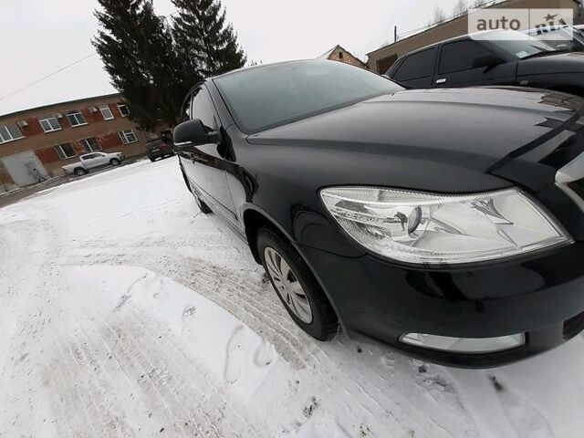 Черный Шкода Октавия, объемом двигателя 1.8 л и пробегом 142 тыс. км за 9200 $, фото 1 на Automoto.ua