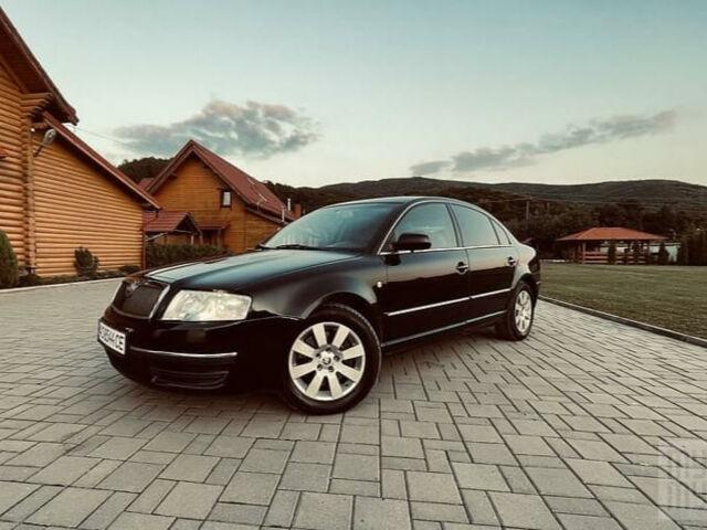 Черный Шкода Суперб, объемом двигателя 2.5 л и пробегом 264 тыс. км за 7999 $, фото 1 на Automoto.ua