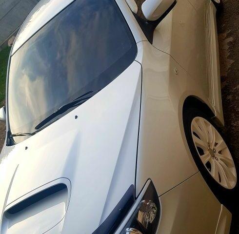 Белый Субару Импреза, объемом двигателя 2.5 л и пробегом 14 тыс. км за 10000 $, фото 1 на Automoto.ua