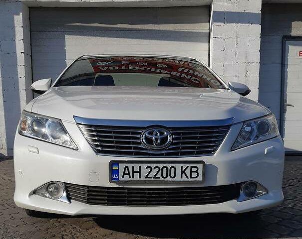 Белый Тойота Камри, объемом двигателя 2.5 л и пробегом 140 тыс. км за 15999 $, фото 1 на Automoto.ua