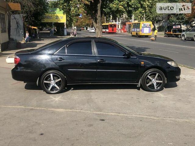 Черный Тойота Камри, объемом двигателя 2.4 л и пробегом 265 тыс. км за 8299 $, фото 1 на Automoto.ua