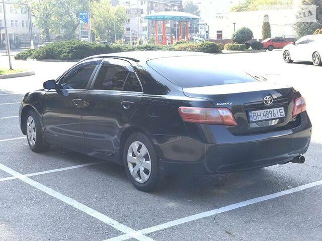 Черный Тойота Камри, объемом двигателя 2.4 л и пробегом 220 тыс. км за 9495 $, фото 1 на Automoto.ua