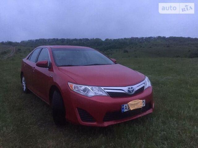 Красный Тойота Камри, объемом двигателя 2.4 л и пробегом 140 тыс. км за 14200 $, фото 1 на Automoto.ua