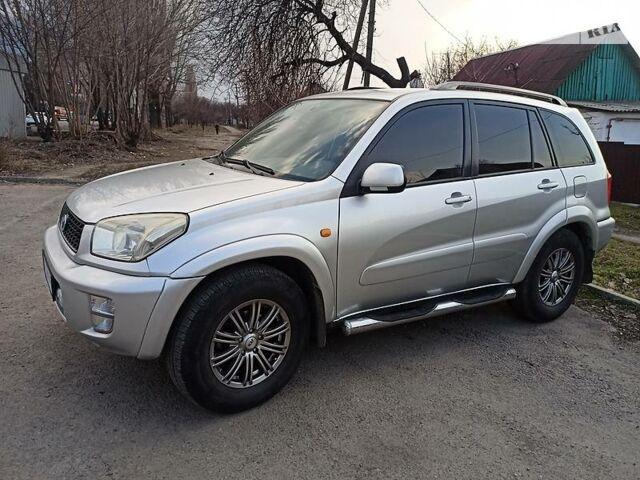 Серый Тойота РАВ 4, объемом двигателя 2 л и пробегом 214 тыс. км за 7000 $, фото 1 на Automoto.ua