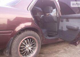Вишнёвый Тойота Карина, объемом двигателя 1.6 л и пробегом 347 тыс. км за 2600 $, фото 3