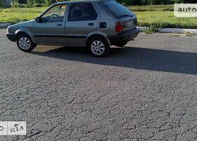 Серый Ниссан Микра, объемом двигателя 1 л и пробегом 197 тыс. км за 550 $, фото 1