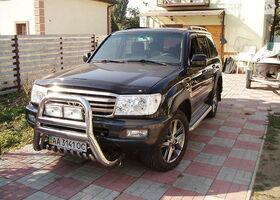 Черный Тойота Ленд Крузер 100, объемом двигателя 0.04 л и пробегом 210 тыс. км за 33000 $, фото 1
