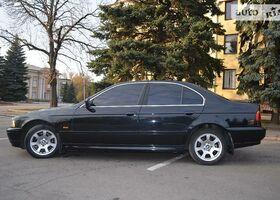Черный БМВ 5 Серия, объемом двигателя 2.5 л и пробегом 320 тыс. км за 8500 $, фото 1
