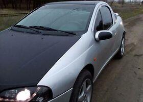 Серый Опель Тигра, объемом двигателя 1.4 л и пробегом 134 тыс. км за 4500 $, фото 1