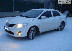 Белый Тойота Королла, объемом двигателя 0.13 л и пробегом 10 тыс. км за 12900 $, фото 1