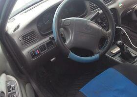 Синій Кіа Кларус, объемом двигателя 2 л и пробегом 390 тыс. км за 3500 $, фото 1