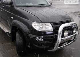 Черный УАЗ Патриот, объемом двигателя 2.5 л и пробегом 256 тыс. км за 7700 $, фото 1