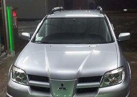 Серый Мицубиси Аутлендер, объемом двигателя 2.4 л и пробегом 128 тыс. км за 10900 $, фото 1